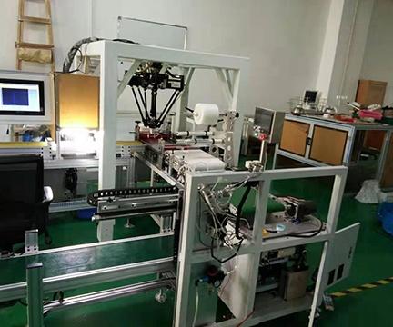蜘蛛手机器人分拣与自动覆膜设备